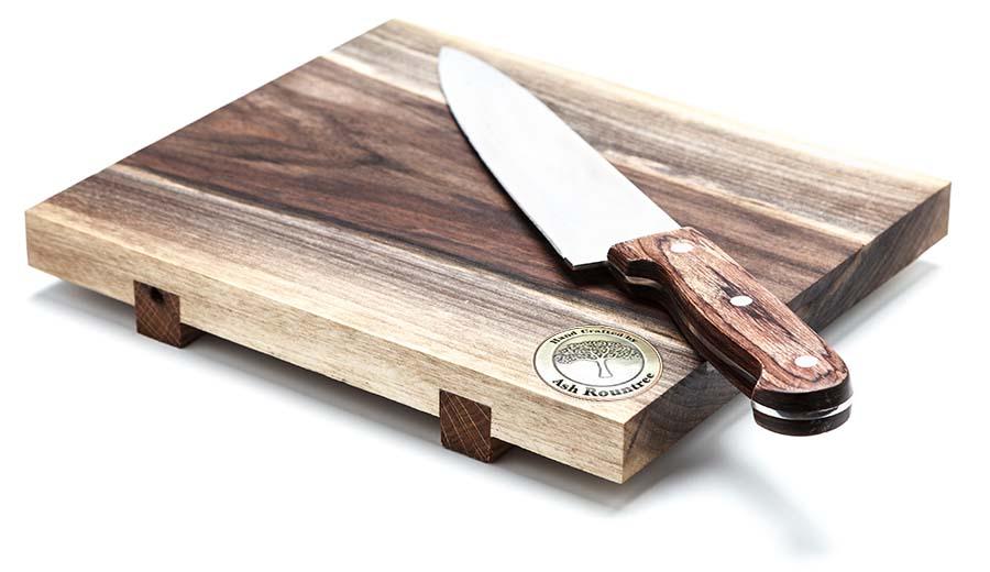 signature coin in a cutting board